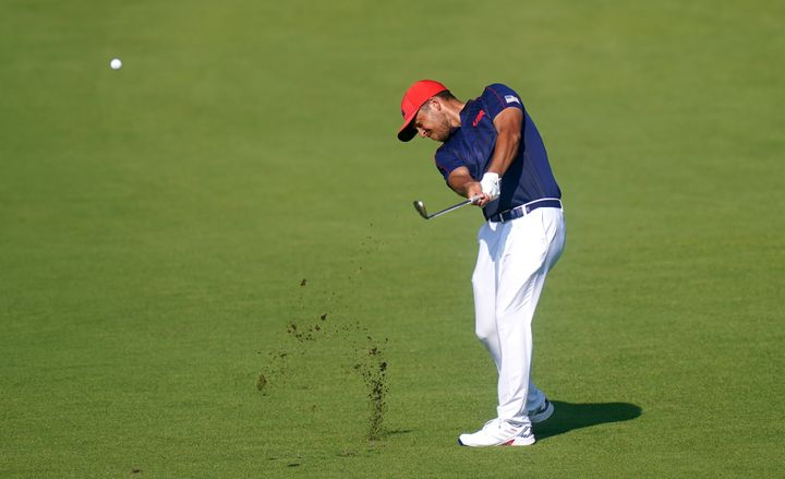 USA's Xander Schauffele in action on the eighteenth hole during the Men's Individual Stroke Golf Tournament at the Kasumigase