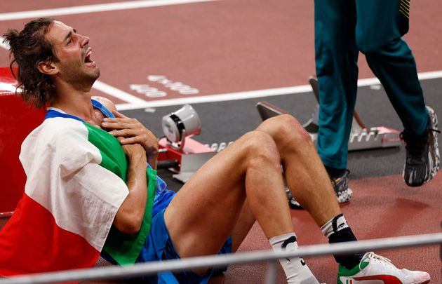 First-placed Italy's Gianmarco Tamberi celebrates after competing in the men's high jump final during...