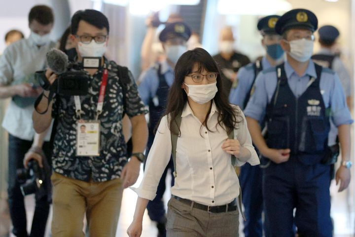 A representative with Japan Lawyers Association for Refugees is seen at Tokyo's Haneda International Airport on Sunday after