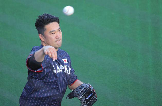 野球準々決勝のアメリカ戦を翌日に控え、練習する田中将大投手=1日、東京都内