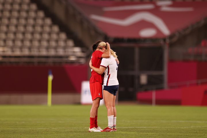 Lindsey Horan of the United States, right, is consoled by a Canadian player after Canada's 1-0 victory.