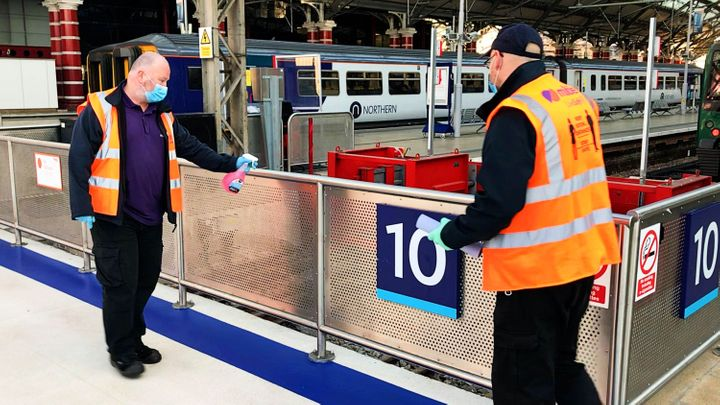 Network rail staff clean stations for Covid-19.