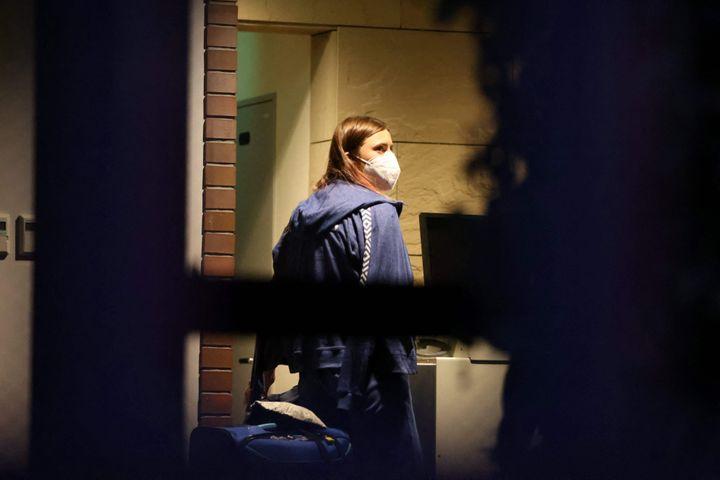 Belarus athlete Krystsina Tsimanouskaya walks with her luggage inside the Polish embassy in Tokyo on Aug. 2, 2021.