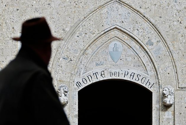 A man walks on January 25, 2013 past the headquarters of the Banca Monte dei Paschi di Siena (MPS), the...