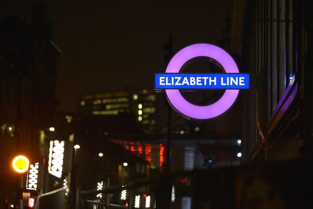 A new London Underground roundel for the Elizabeth Line is illuminated outside the new Crossrail