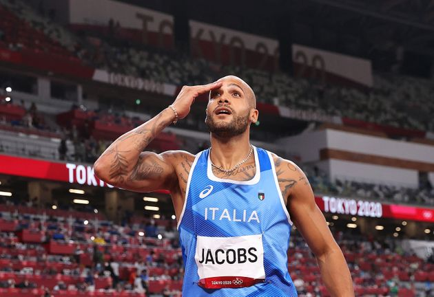 Italy's Lamont Marcell Jacobs celebrates after winning the men's 100m final during the Tokyo 2020 Olympic...