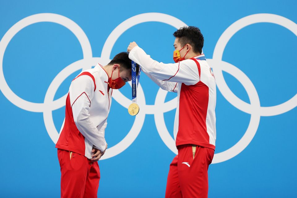 Gold medalists Zongyuan Wang and Siyi Xie of Team China during the medal ceremony for the men's synchronized...