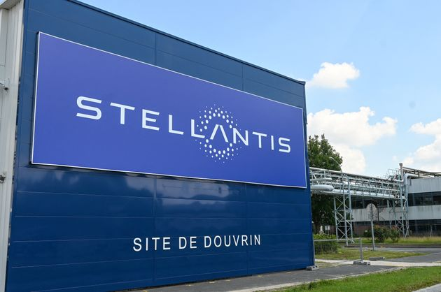 A picture taken in Douvrin, on July 2, 2021 shows the entrance of the plant of Dutch multinational automotive...