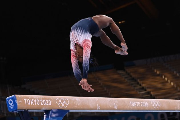 Simone Biles competes in the artistic gymnastics women's balance beam final of the Tokyo 2020 Olympic...