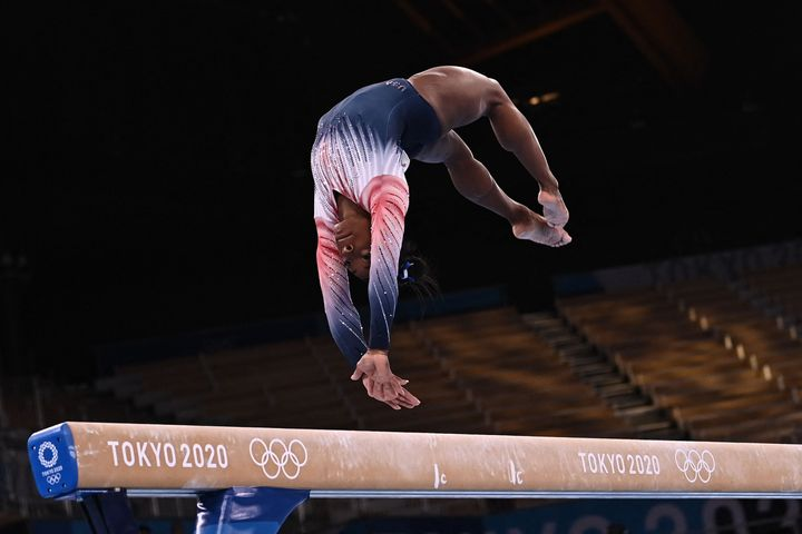 Simone Biles competes in the artistic gymnastics women's balance beam final of the Tokyo 2020 Olympic Games at Ariake Gymnast