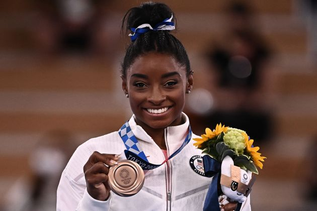USA's Simone Biles poses with her bronze medal during the podium ceremony of the artistic gymnastics...
