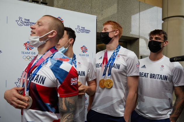 Adam Peaty, James Guy, Tom Dean and Jacob Peters arriving at Sheraton Heathrow Hotel on August 02,