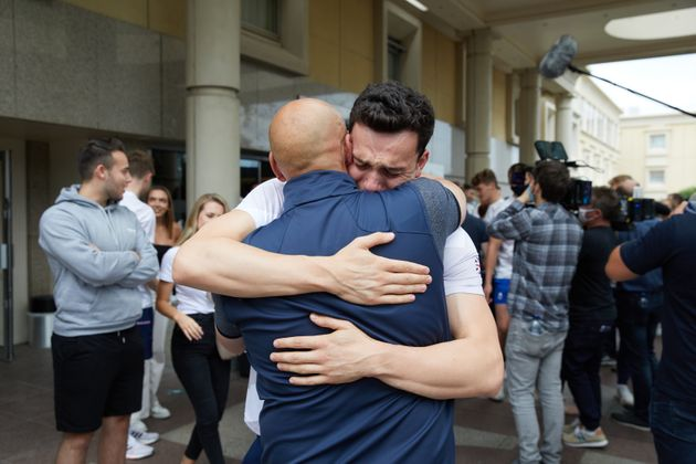 James Guy hugs his father Andrew
