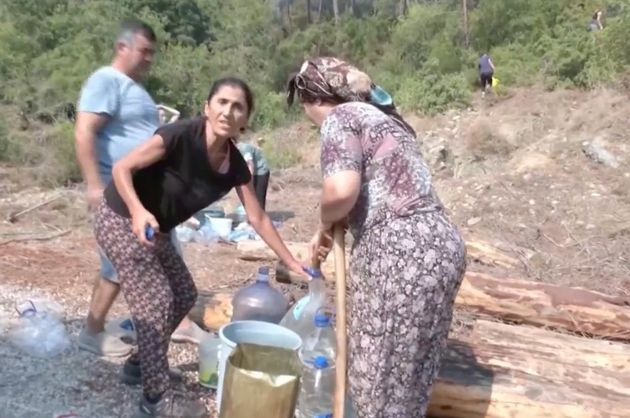 Residents tackling the local fire with water bottles despite