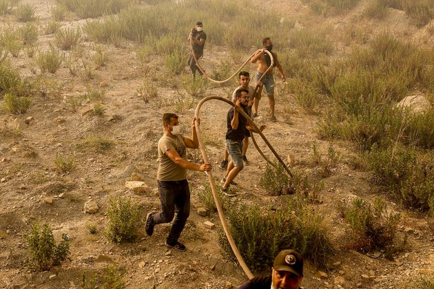 People help with the fight against forest fires broke out in Manavgat district of