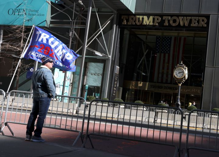 Former President Donald Trump's supporter stands in front of Trump Tower in New York on March 7, 2021.