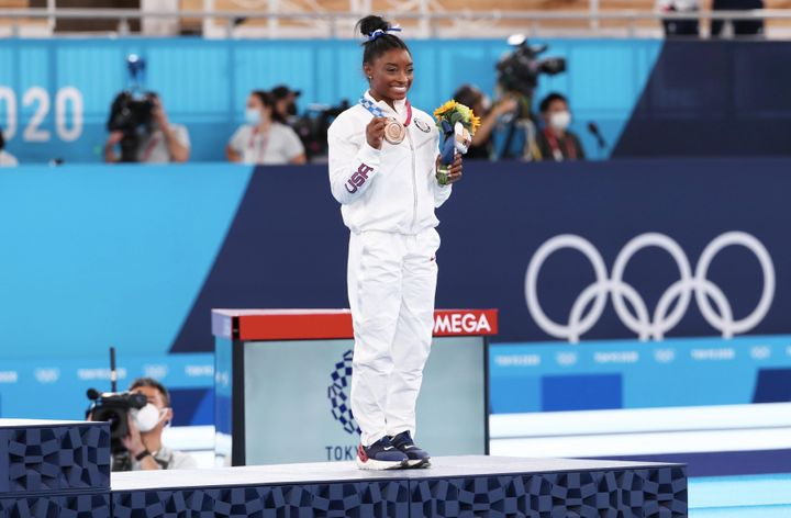 Simone Biles celebrates her bronze medal after the Women's balance beam final on Aug. 3, 2021, in Tokyo.