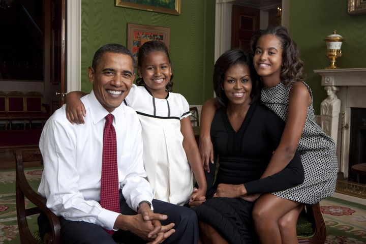 The Obama family sits for a portrait in the Green Room of the White House on Sept. 1, 2009.