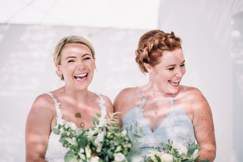 Natasha Infantino with her sister Naomi after her wedding in Santorini in 2018.