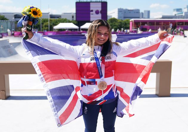 Great Britain's Sky Brown celebrates winning the bronze medal during the Women's Park Final at the Tokyo...