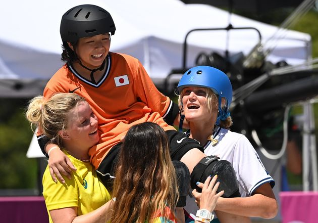 Okamoto Misugu is carried off after she fell on her last run in the skateboarding park