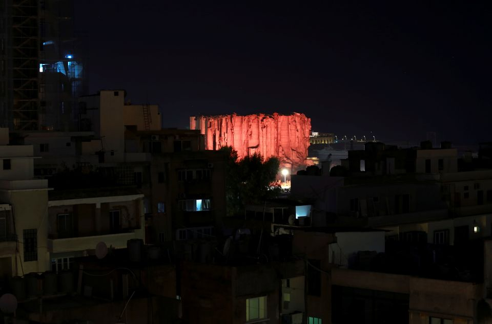 Lebanon marks one year anniversary of Beirut port explosion by lighting up a damaged