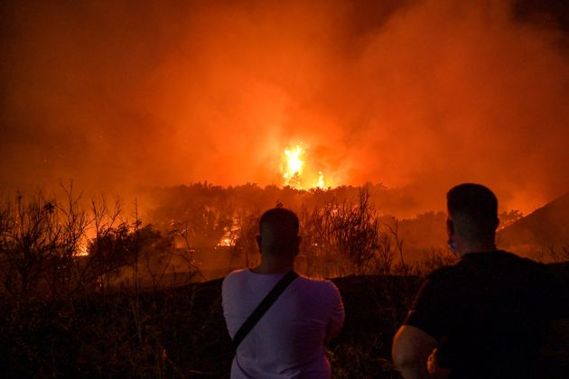ATHENS, GREECE - AUGUST 03:Local residents watch a wildfire in the area of Tatoi areia on August 3, 2021...