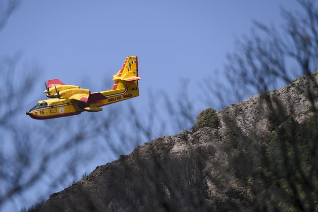 ORISTANO, ITALY - JULY 30: A canadair of the Fire Brigade at work to try to extinguish the last outbreaks...
