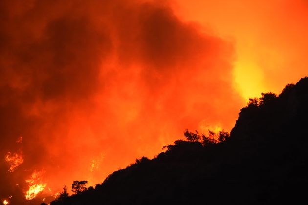 Smoke rises as ground and aerial extinguishing operations after forest fire broke out in Milas district...