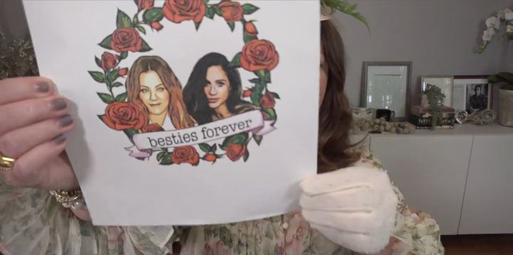 McCarthy shows Meghan the mock-up of a tattoo in the Duchess 40x40 announcement video.