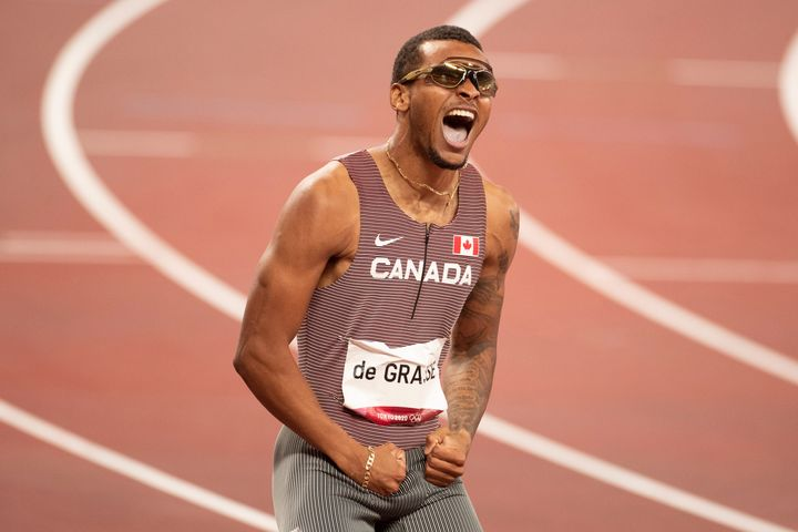 TOKYO, JAPAN August 4: Andre de Grasse of Canada celebrates after his victory in the 200m Final for Men during the Track and Field competition at the Olympic Stadium at the Tokyo 2020 Summer Olympic Games on August 4, 2021 in Tokyo, Japan. (Photo by Tim Clayton/Corbis via Getty Images)
