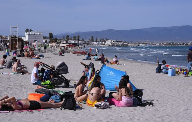 People relax on a beach in Cagliari, Sardinia, Italy, on May 28, 2021. All Italian regions have turned...