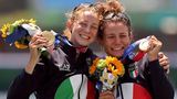 Italian gold medalists Valentina Rodini and Federica Cesarini with the bouquets following their victory in the women's lightweight double sculls.