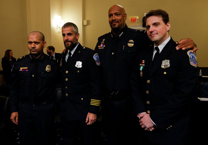 U.S. Capitol Police Sgt. Aquilino Gonell, Metropolitan Police Department Officer Michael Fanone, U.S. Capitol Police Officer Harry Dunn and Metropolitan Police Officer Daniel Hodges stand together on July 27 following the opening hearing of the House select committee investigating the Jan. 6 attack on the U.S. Capitol.
