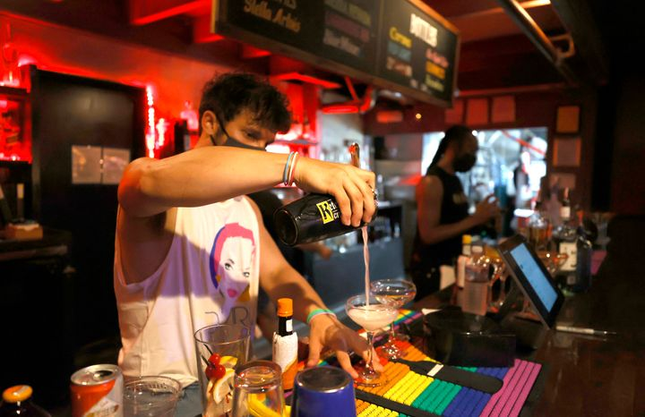 A bartender makes cocktails at Oasis in San Francisco on July 29. The San Francisco Bar Owner Alliance is encouraging members to require bar customers to show proof of vaccination or a negative COVID-19 test within 72 hours of a bar visit.