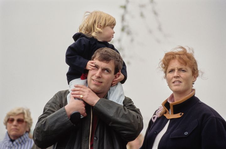 Princess Beatrice on Prince Andrew's shoulders, with Ferguson at right ht, at the Royal Windsor Horse Show in May 1990.
