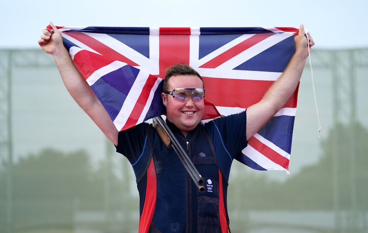 Matthew Coward-Holley celebrates after his bronze in the Trap Men's final