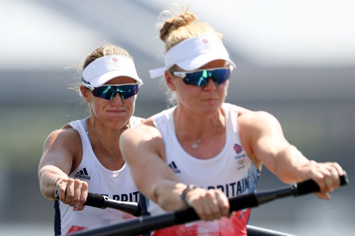 Helen Glover and Polly Swann compete during the Women's Pair heats on the first day of the games.