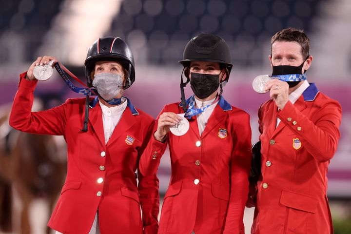 Laura Kraut, Jessica Springsteen and McLain Ward pose with their silver medals.