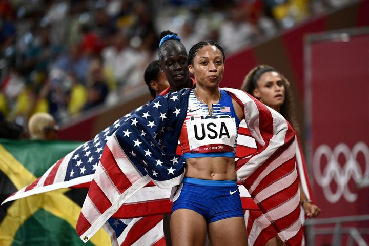 Team USA's Allyson Felix celebrates after winning the women's 4x400-meter relay final during the Tokyo Olympics.