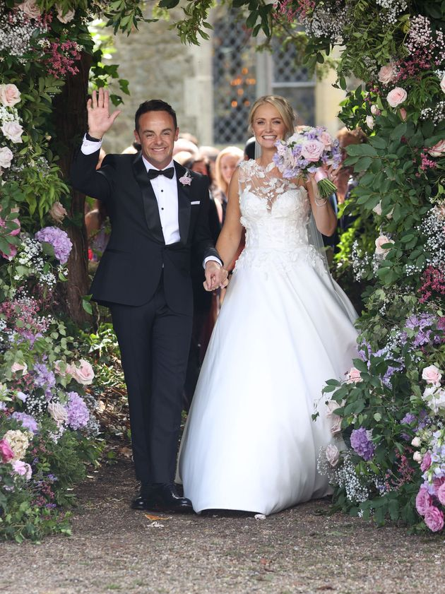 The newlyweds beamed as they left the