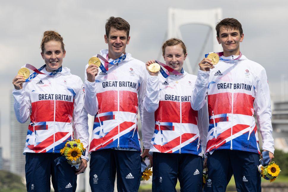 Team GB's Mixed Relay Triathlon team show off their gold medals