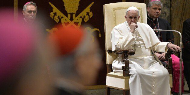 Pope Francis attends an audience of the Curia, the administrative apparatus of the Holy See, for Christmas greetings in the Sala Clementina of the Apostolic Palace at the Vatican, on December 22, 2014. AFP PHOTO / ANDREAS SOLARO (Photo credit should read ANDREAS SOLARO/AFP/Getty Images)