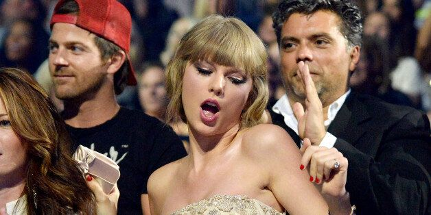 NASHVILLE, TN - JUNE 05:  Musician Taylor Swift dances in the audience during the 2013 CMT Music Awards at the Bridgestone Ar