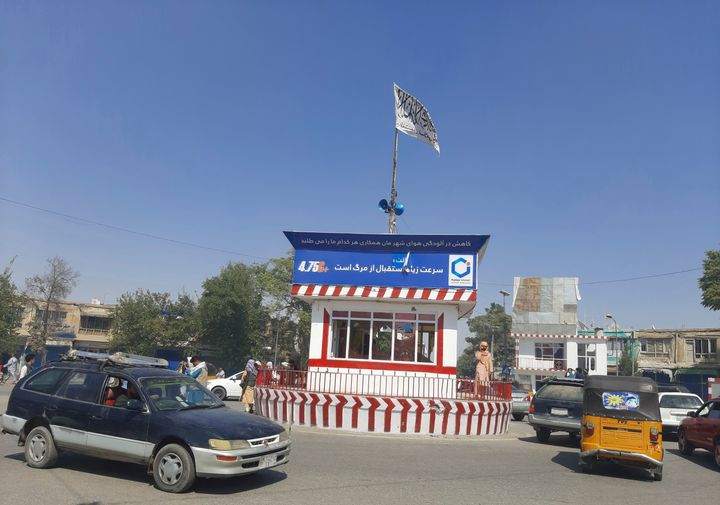 A Taliban flag flies in the main square of Kunduz city after fighting between Taliban and Afghan security forces, in Kunduz, Afghanistan, on Aug. 8, 2021.