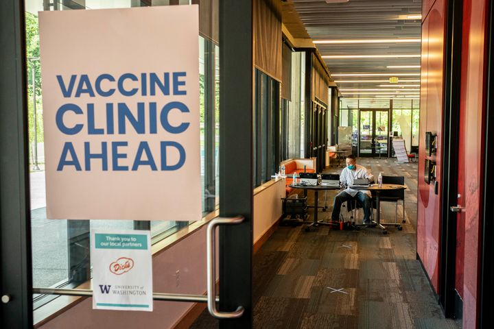 A pharmacist waits for patients at a COVID-19 vaccination clinic on the University of Washington campus on May 18, 2021 in Seattle, Washington. (Photo by David Ryder/Getty Images)