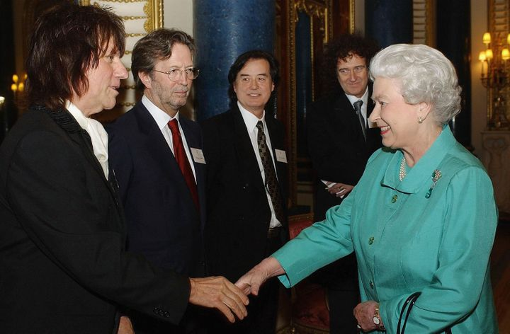 Musicians (from left) Jeff Beck, Eric Clapton, Jimmy Page and Brian May greet Queen Elizabeth II in 2005.