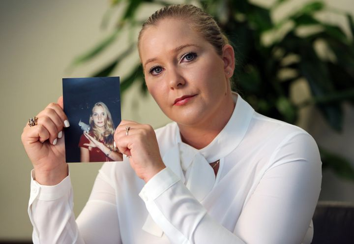 Virginia Roberts holds a photo of herself at age 16, when she says Jeffrey Epstein began abusing her sexually.