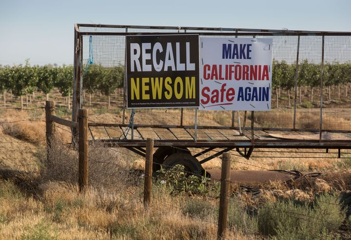 Signs supporting the Newsom recall are seen in Gustine, California.