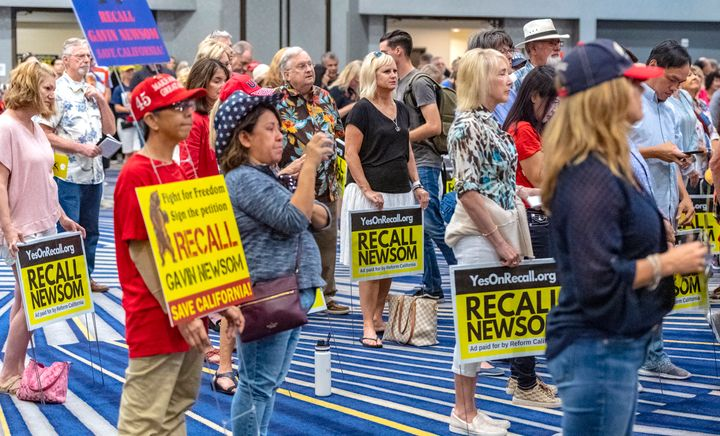 Pro-recall supporters listen to Carl DeMaio of Reform California at a rally in Irvine, California, July 31, 2021.